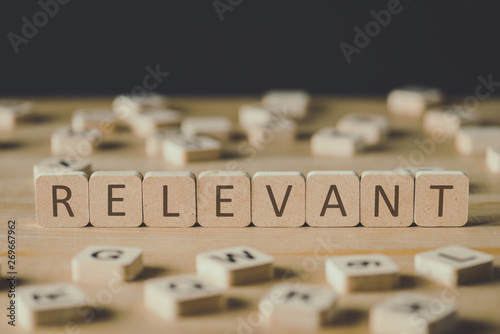 Fotografija selective focus of relevant inscription on cubes surrounded by blocks with lette
