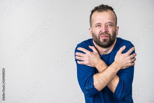 Man feeling cold gesturing Fototapet