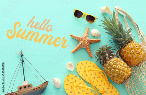 Recess Fitting India Ripe pineapple and beach sea life style objects over pastel mint blue wooden background. Tropical summer vacation concept