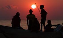 Silhouettes Of Fishermen At Su...