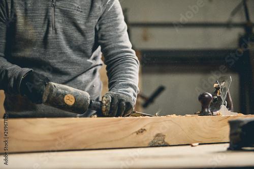 Fototapeta Carpenter at work on wood table with tools obraz na płótnie