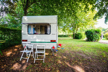 Caravan Trailer On A Green Lawn Under The Trees, On A Sunny Summer Day. Poix De Picardie, France.