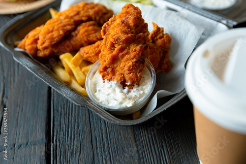 Cuadros en Lienzo Fried chicken and french fries and in a takeaway container on the wooden background