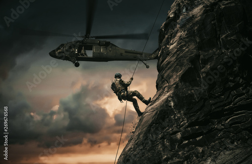 Obraz Military helicopters and forces roping in destroyed city. - fototapety do salonu