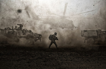 Military forces between storm & dust in desert