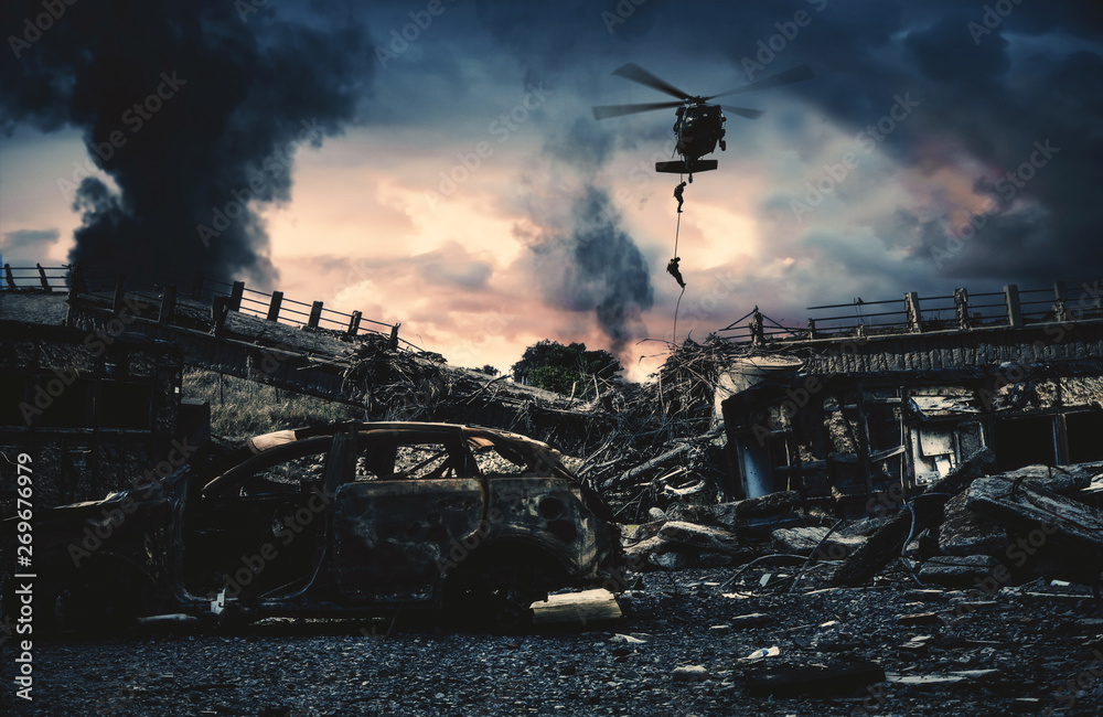 Fototapeta Military helicopter and forces in destroyed city to find leader of enemy.