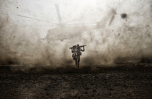 Military Soldier And Helicopter Between Storm & Dust