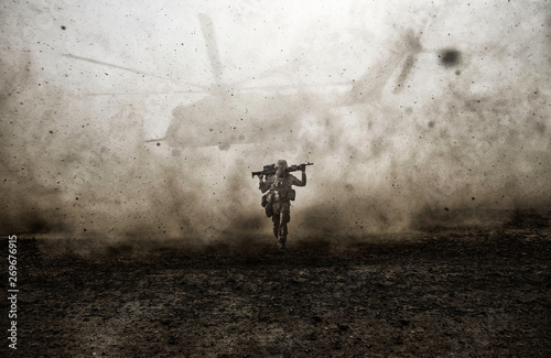 Slika na platnu Military soldier and helicopter between storm & dust