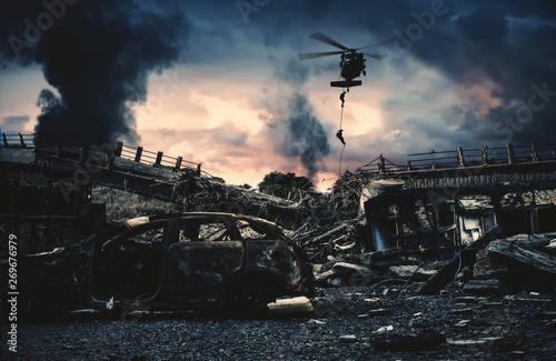 Slika na platnu Military helicopter and forces in destroyed city to find leader of enemy