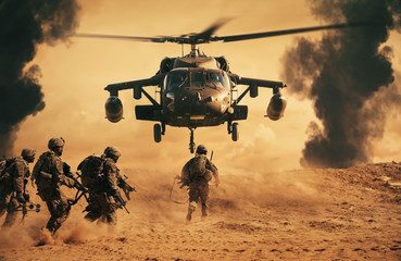 Fototapeta Militaria Military soldiers are running to the helicopter in battlefield