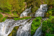Mountain river waterfall landscape. Cascade of Dzhurynskyi waterfall. Nyrkiv, Ukraine