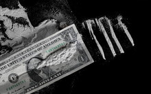 One Dollar And Cocaine Lines Isolated On Black Background