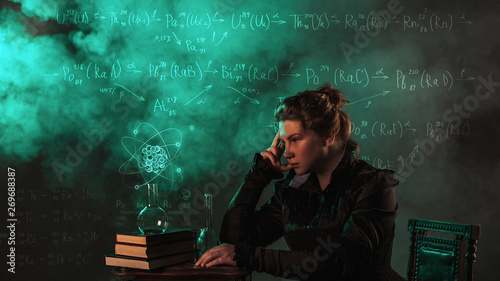 Fotografia  Scientist researcher on abstract background of schemes and formulas