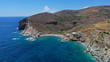 Aerial drone photo of secluded deep turquoise beach of Agios Nikolaos with crystal clear sea and sandy sea shore, Folegandros island, Cyclades, Greece
