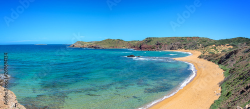 Panorama of Cala Cavalleria beach in Menorca, Balearic islands, Spain