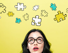 Puzzle Pieces With Young Woman Wearing Eye Glasses