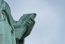 USA, New York - May 2019: Book Held By Showing 4th Of July, Statue Of Liberty, Liberty Island