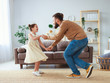 canvas print picture Happy father's day! family dad and child daughter Princess dancing