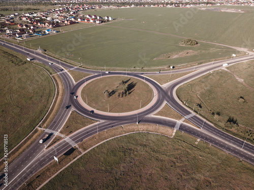 fototapeta na lodówkę Top down aerial view of a traffic roundabout on a main road