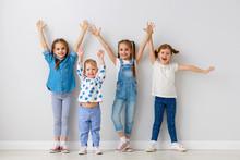 Happy Kids Friends Around Empty Walls.