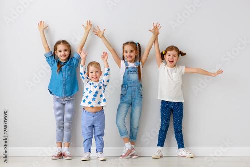 Photo  happy kids friends around empty walls.