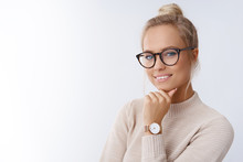 Close-up Shot Of Smiling Attractive Happy And Successful European Blond Female In Sweater Watch And Glasses Grinning Expressing Confidence, Looking Accomlished And Daring At Camera With Sassy Smile
