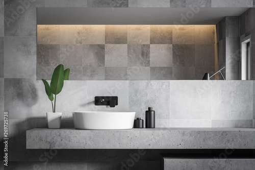 Pinturas sobre lienzo  Close up of gray tile bathroom with sink