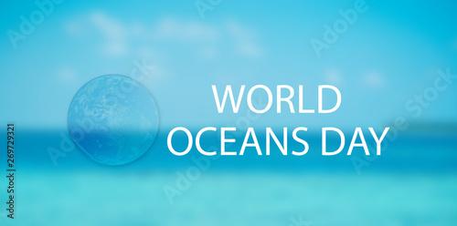 Fotografie, Obraz  sphere global inside water drop on blur blue background for world oceans day c
