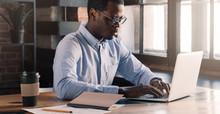 Modern African Man Using Lapto...