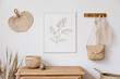 Leinwanddruck Bild - Stylish korean interior of living room with brown mock up poster frame, elegant accessories, flowers in vase, wooden shelf and hanging rattan leaf, bags. Minimalistic concept of home decor. Template.