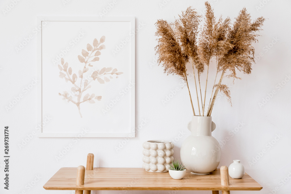 Fototapeta Stylish korean interior of living room with white mock up poster frame, elegant accessories, air plant, wooden shelf and vase with flowers. Minimalistic concept of home decor. Template. Bright room.