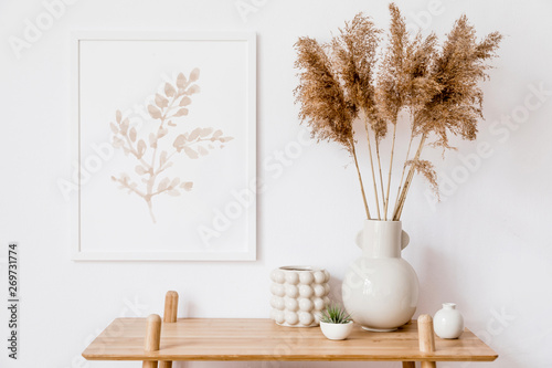 Photo  Stylish korean interior of living room with white mock up poster frame, elegant accessories, air plant, wooden shelf and vase with flowers