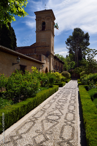 Stone patterned garden walkway of San Francisco convent with Bell Tower at Alham Fotobehang