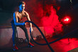 canvas print picture Male athlete stops doing boring cardio workouts and starts using the battle ropes to really crank it up. Man will easy get winded, fatigued and burn those calories faster with these moves
