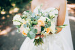 canvas print picture - wedding bouquet with white carnations and ranunculi. delicate bouquet in yellow and white. eucalyptus leaves.