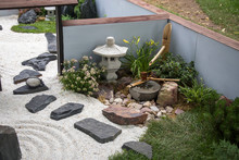 The Japanese Garden With Ikebana, Sand And Rake
