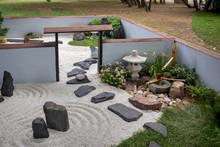 The Japanese Garden With Ikebana, Sand And Rake