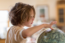 5 Year Old Boy Touching Globe