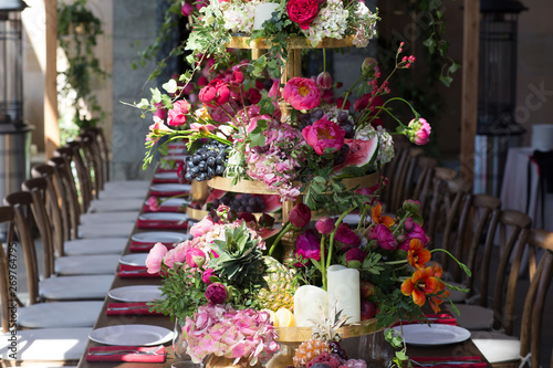 Obraz na plátně Wedding table decor in red white pink colors
