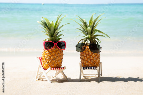Pineapple With Sunglasses On Deck Chair At Beach - 269765738