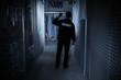 Leinwandbild Motiv Security Guard Standing In The Warehouse