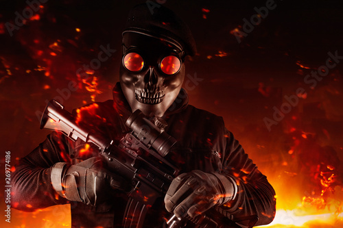 Soldier in skull mask, rifle, glasses and beret face front view. Wallpaper Mural