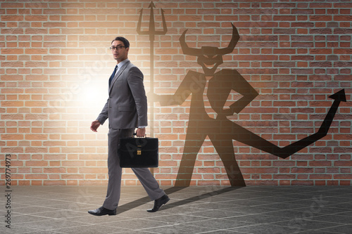 Devil hiding in the businessman - alter ego concept Fototapeta