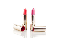 Two Red And Pink Lipsticks In Golden Tube On White Background With Mirror Reflection On Glass Surface Isolated Closeup, Open Lipstick In Shiny Gold Package, Luxury Cosmetic Accessory Set, Studio Shot