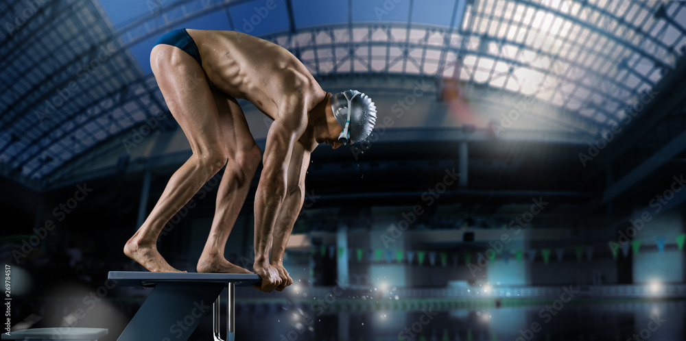 Fototapety, obrazy: Swimming pool. Muscular swimmer ready to jump.