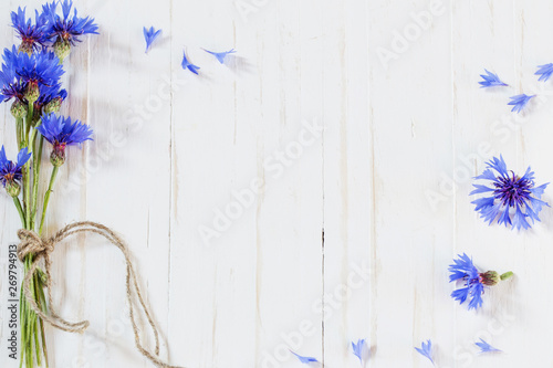 cornflowers on white wooden background - 269794913