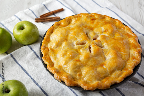 Photo  Homemade apple pie on cloth, side view. Close-up.