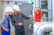 Leinwandbild Motiv  boss with worker in factory