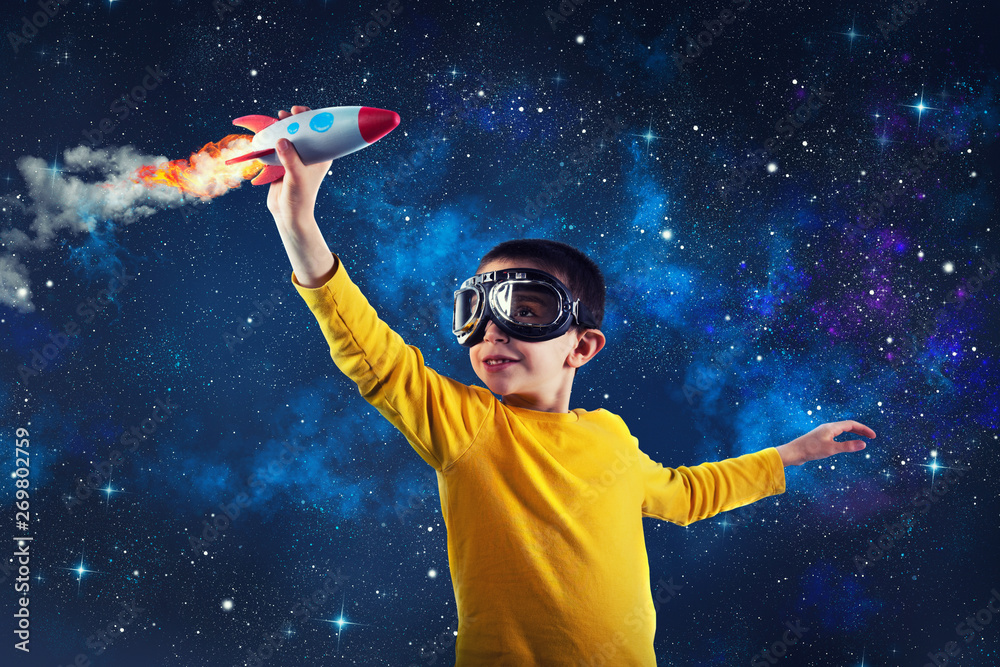 Fototapety, obrazy: Child plays with a rocket. Concept of imagination
