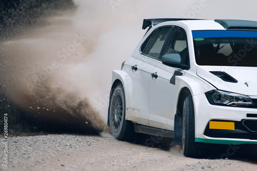 Rally car make a turn with the clouds of sands and dust Wallpaper Mural